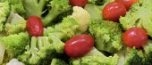 Closeup of broccoli and tomato salad platter