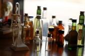 Fotografie Various vintage medicine bottles and skeleton toy on table