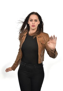 portrait of brunette girl wearing brown leather jacket.  isolated on white studio background.