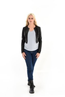 Full length portrait o blonde girl wearing leather jacket and jeans. standing pose, isolated against white studio background. stock vector