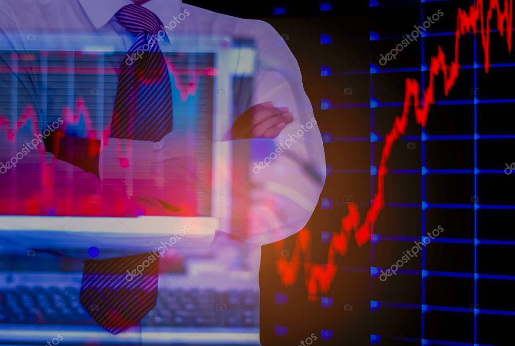 double exposure  business man, computer and stock chart as background,  With concept of risk and volatility of investment world market.