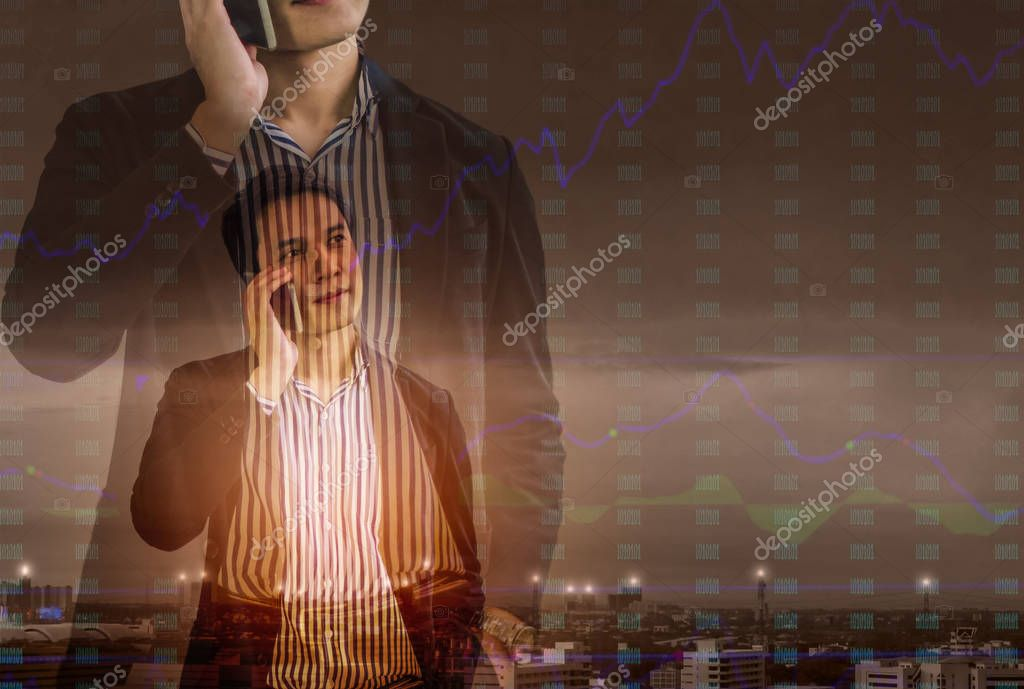 Double exposure - Businessmen stand talking on the phone and chart stock trading, landscape behind the city,Concept vision success of corporate leaders.