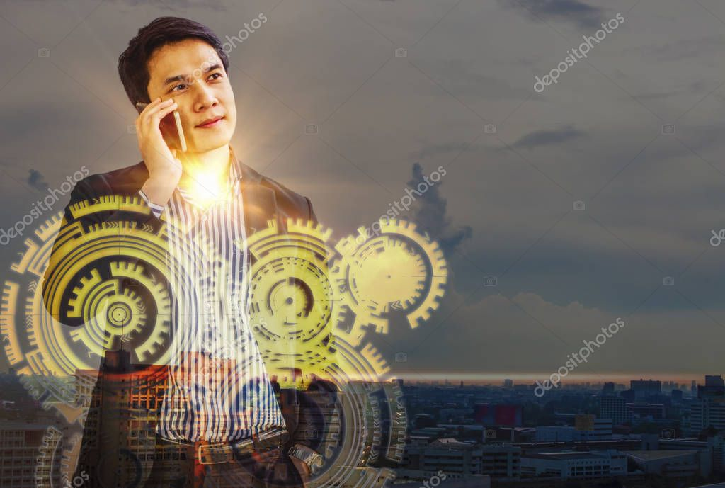 Double Exposure- businessman standing talking on phone, landscaped city behind with media icons for modernity, Concept vision success of corporate leaders.
