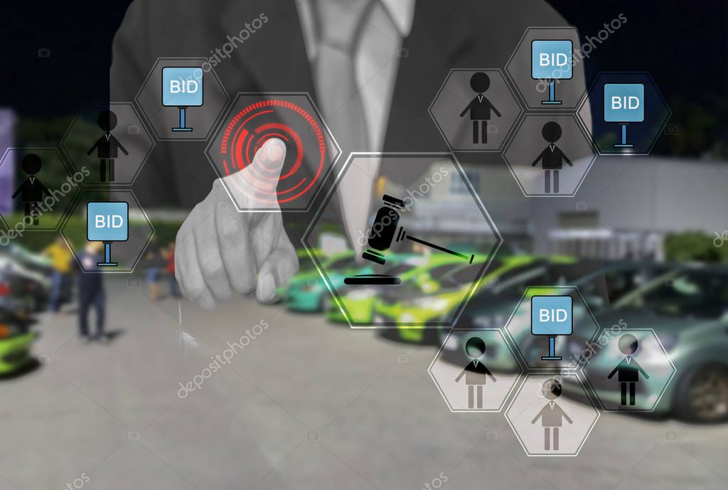 Businessmen touch  hologram button, For online shopping, select  car in  online market,  with  concept of convenience in buying cars through  internet of customers.