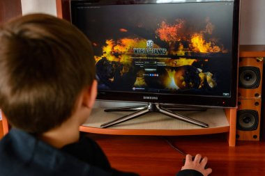 LVIV, UKRAINE - MARCH 08, 2019: Illustration of a computer game World of Tanks, showing a teenager playing this game
