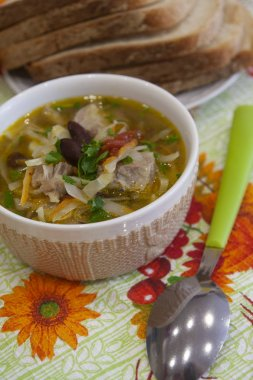 Hot winter soup with meat, beans and cabbage. Food photo