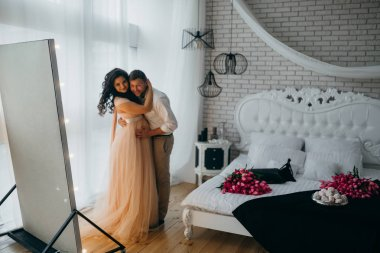 happy  married couple embracing  at home
