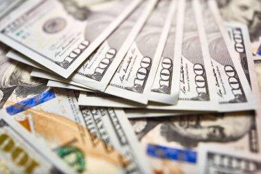 Macro shot of a new 100 dollar bill. Background of 100 dollar bills