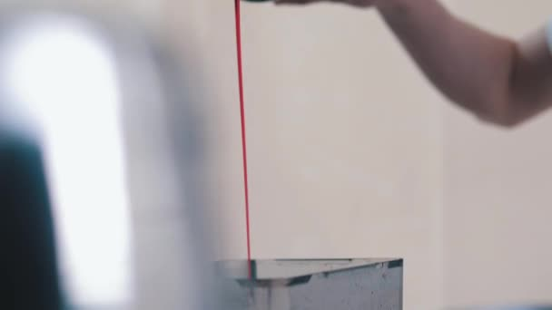 Cherry syrup is poured from