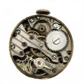 Vintage old clockwork isolated on the white background. Macrophoto of a tiny old clockwork background