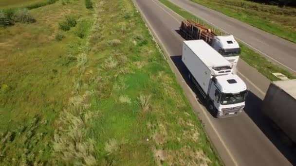 A white isothermal van is moving along the highway