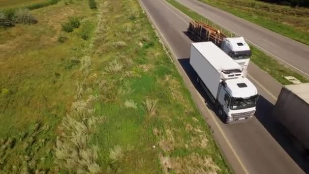 Aerial view of a white isothermal van is moving along the highway
