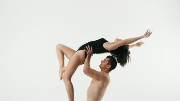 Dance training, a man raised a girl in his arms holding her waist