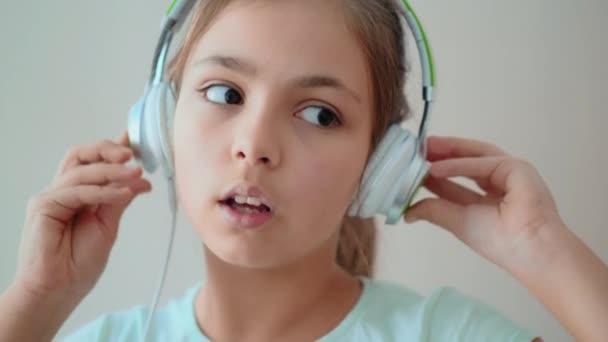 Cute teenage girl listening to music through headphones