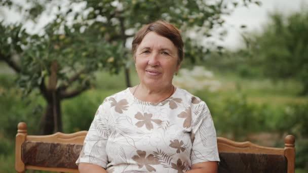 Portrait of an elderly brunette woman outdoors