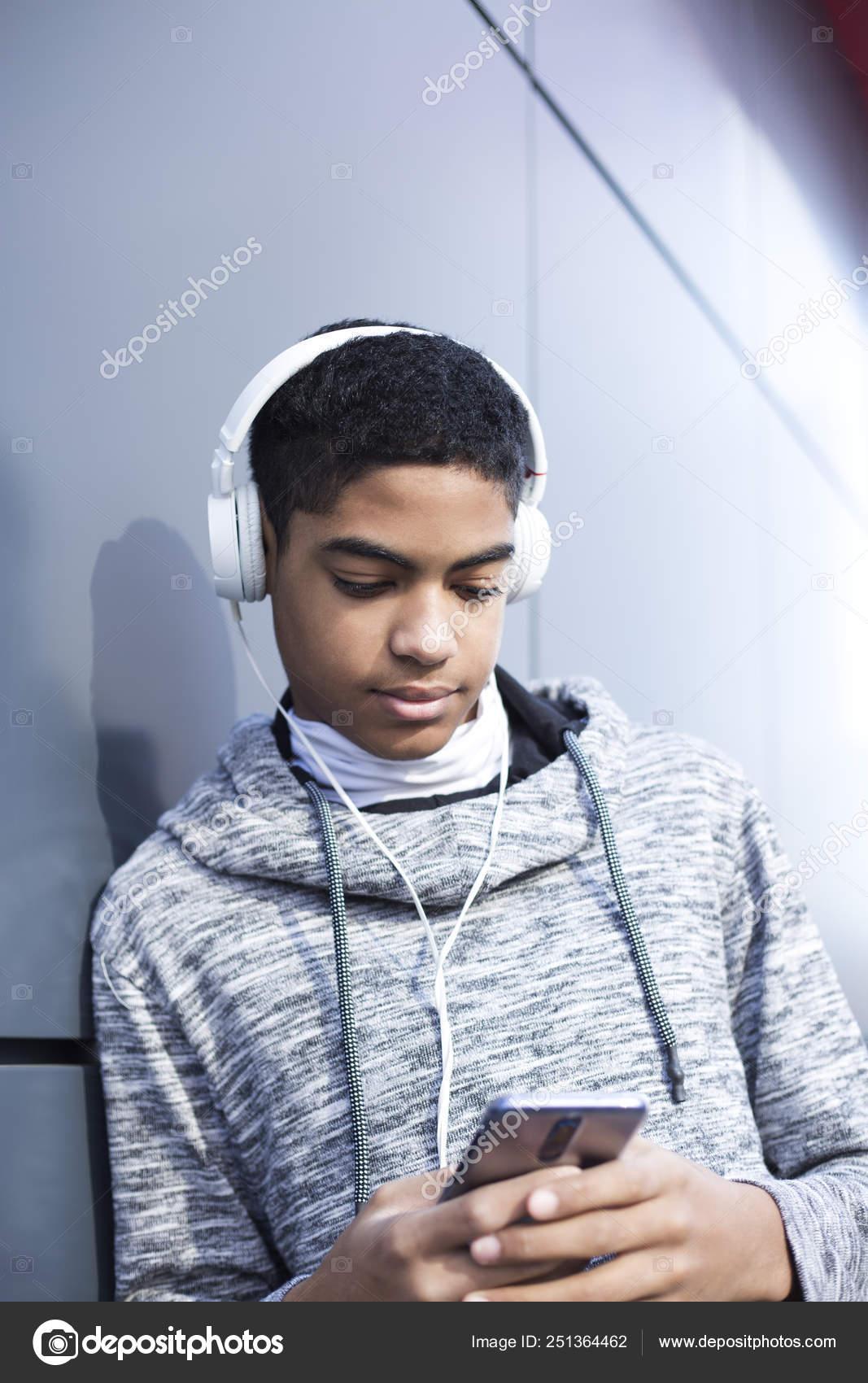Afro American Boy Teenager Headphones Listening Music Mobile Phone Cute Stock Photo C Sasha2109 251364462