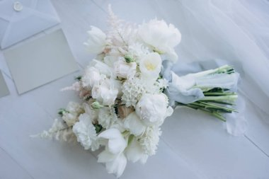 top view of beautiful bridal bouquet on white wooden floor