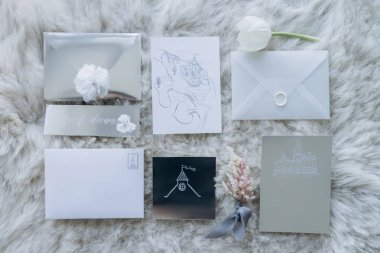top view of wedding invitations on furry carpet