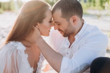 beautiful tender couple on beach with backlit