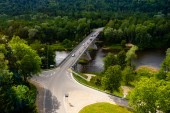 Fotografie aerial view of road with green trees around, Riga, Latvia