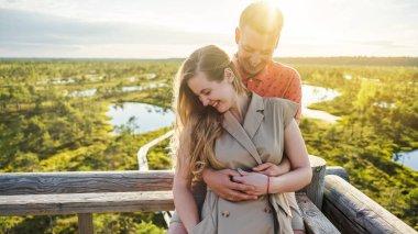 Portrait of happy couple in love hugging on wooden bridge stock vector