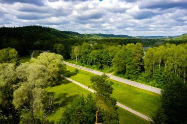 scenic view of blue cloudy sky, road and green trees, Riga, Latvia