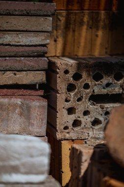macro shot of old bricks stacked in the garden