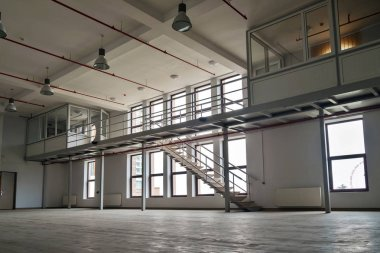 Interior of a large empty room with mezzanine