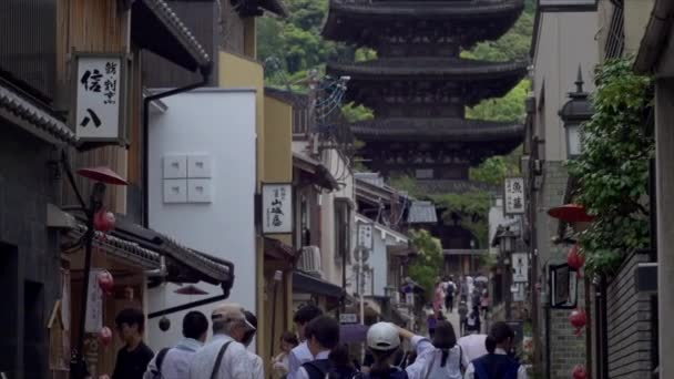 people watching on buildings and temple of Kyoto, Japan