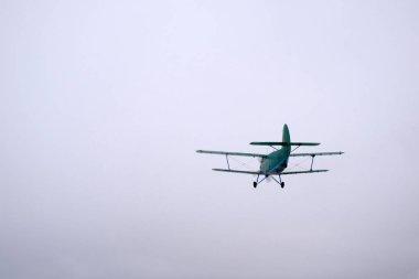 Winter season. A green biplane has just taken off. stock vector