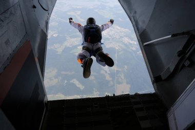 Skydiving. Exit. The start of the jump. A skydiver has just jumped out of a plane.