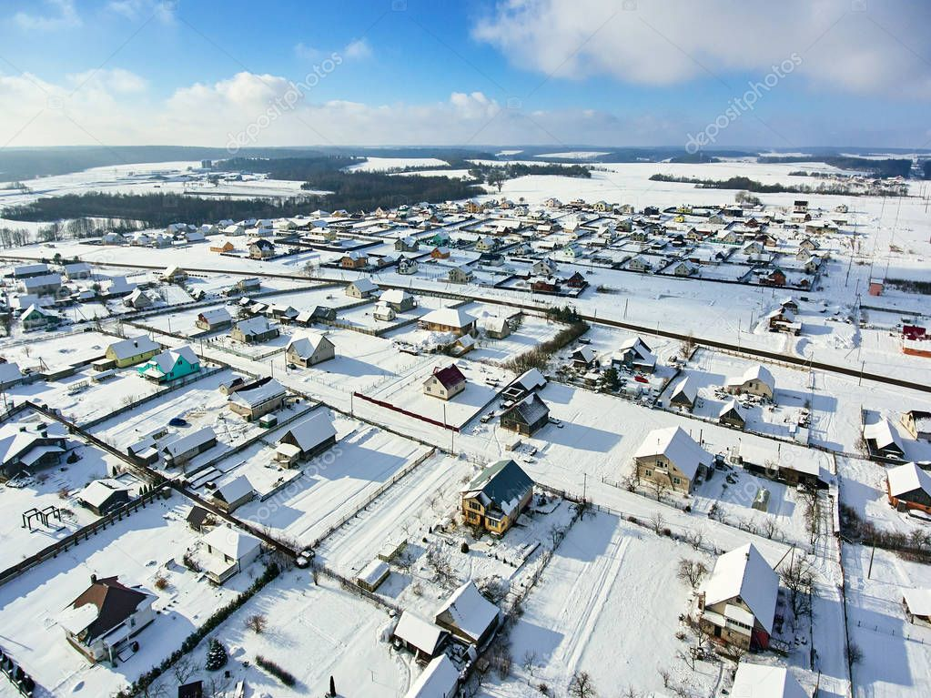 many village houses in the snow from air