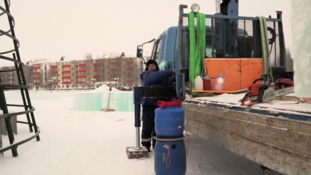 The driver of the hydraulic manipulator in the workplace Portrait of a hydraulic crane driver at the construction of an ice town