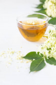 Tea and syrup from elderberry flowers Sambucus on a white background.