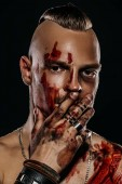 Fotografie Fight club, MMA. Portrait of a bad guy fighter with a face in the blood, demonstrating his muscles and strength. Rocker, punk.