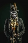 Fotografie Muž s lebka make-up oblečený ocas kabát a cylindr. Baron sobota. Baron Samedi. Dia de los muertos. Den mrtvých. Halloween