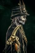 Fotografie Ein Mann mit einem Schädel-Make-up, gekleidet in einen Frack und einen Zylinder. Baron Samstag. Baron Samedi. Dia de Los Muertos. Day of The Dead. Halloween