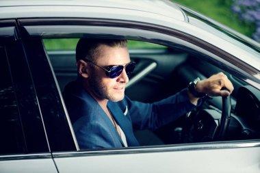 Mature man driving a car. Vehicle concept.