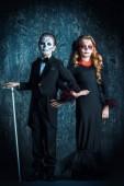 Fotografie Portrét dětí v kostýmech Calavera Catrina a kostra. Halloweenskej karneval. Dia de los muertos. Den mrtvých