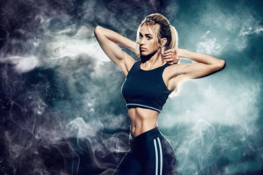 Portrait of a beautiful athletic woman with perfect muscular body. Active, healthy lifestyle. Fitness, bodybuilding.