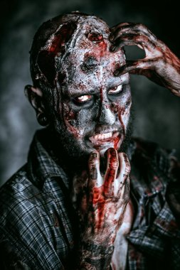 Close up of a creepy scary zombie. Halloween. Horror film.