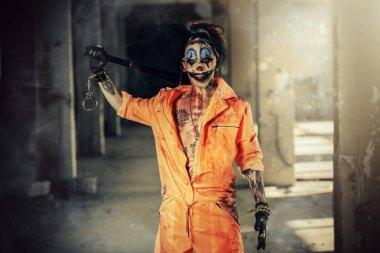 Crazy evil clown man stained in blood. Halloween. Horror, thriller film.