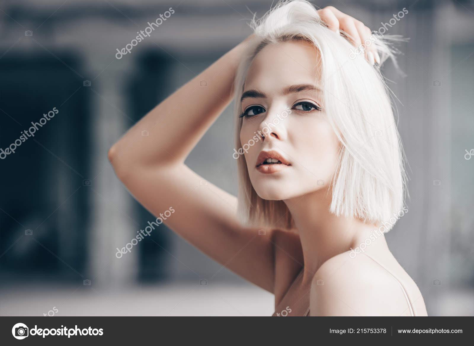 Closeup Portrait Of Young Beautiful Blonde Woman Posing In