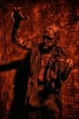 Fotografie Strašidelné strašidelný zombie v červené světlo. Halloween. Horor film
