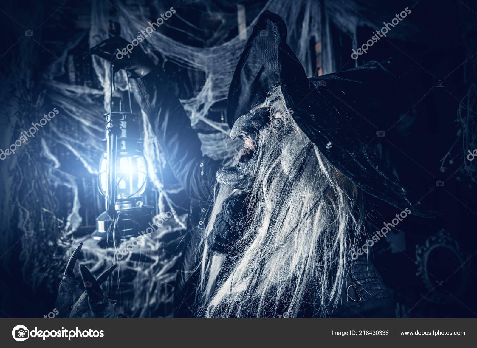 Witch Holding Torch Halloween Horror Movie — Stock Photo © prometeus