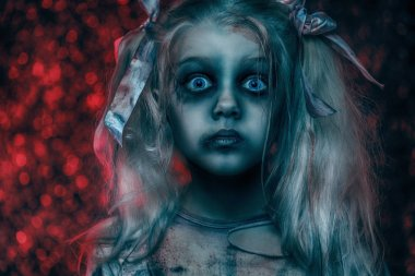 A close-up portrait of a scary zombie girl. Halloween. Horror film.