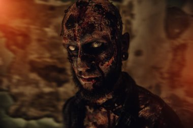 A close-up of a creepy scary zombie. Halloween. Horror film.