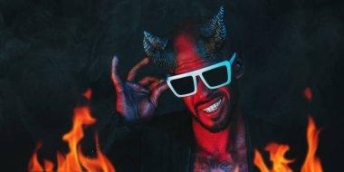 A portrait of a bad demon in sunglasses. Horror movie, nightmare. Halloween.