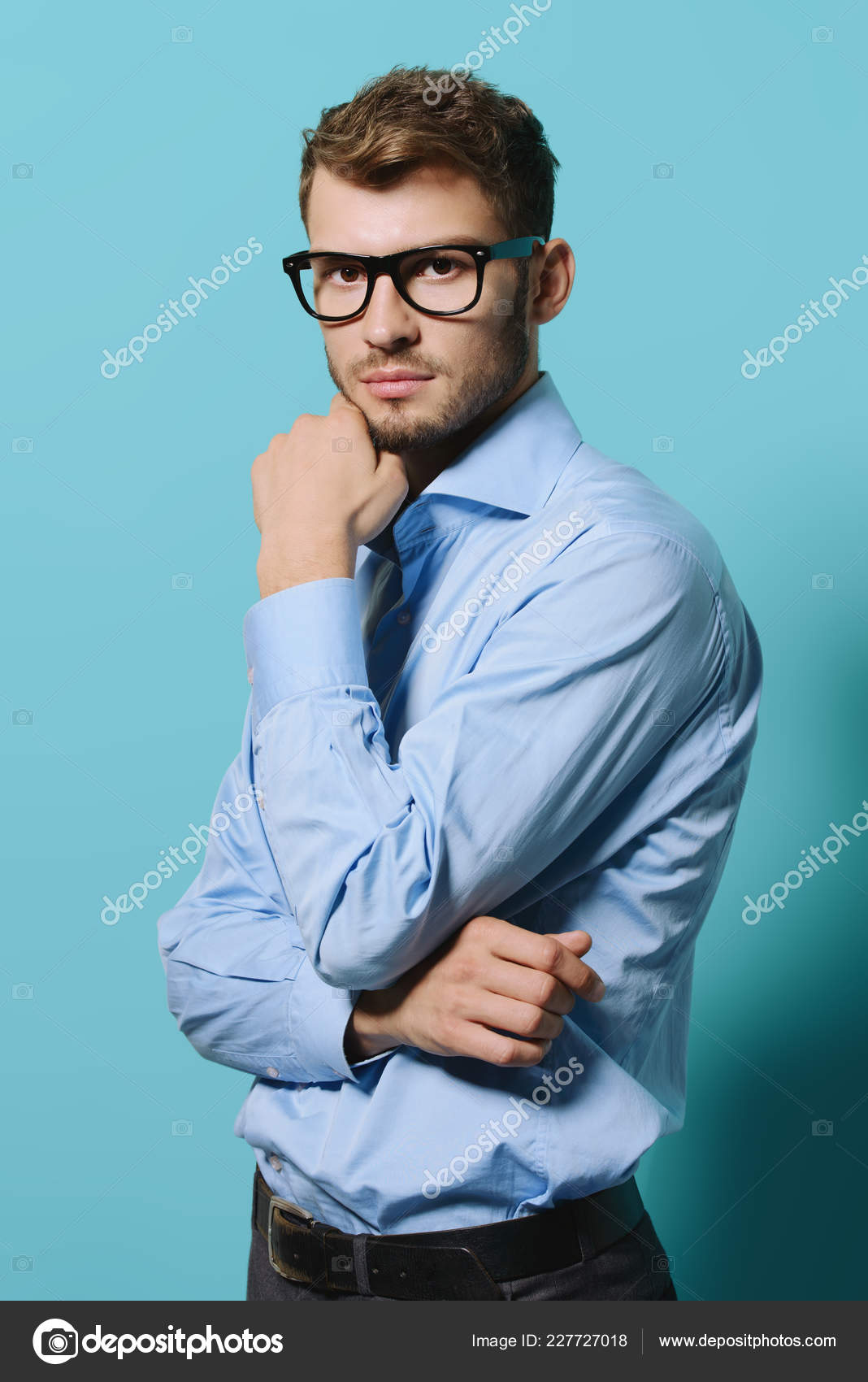 a00eba5facc6 Elegant man in glasses over blue background. Optics style for men. Handsome  businessman in spectacles. Male beauty, fashion.