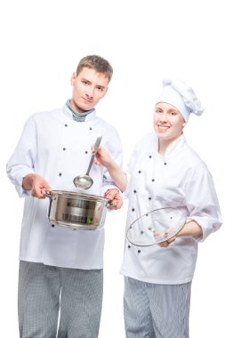 successful professional chefs with pan and a ladle on a white ba